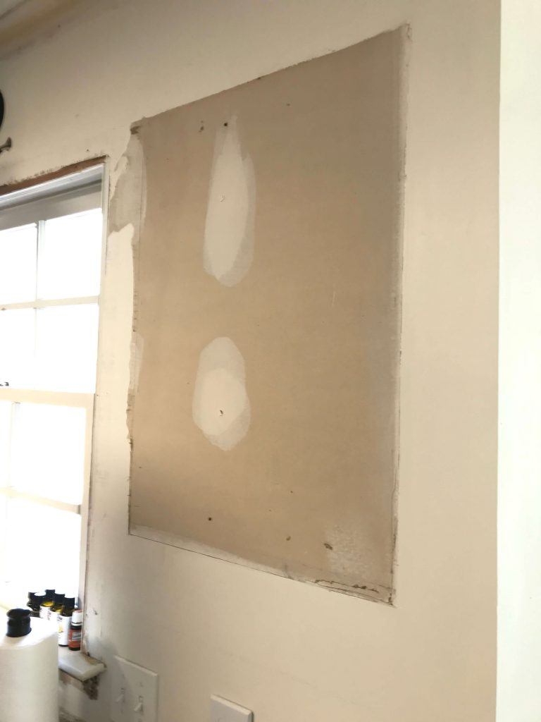 empty drywall where single shelf in kitchen was
