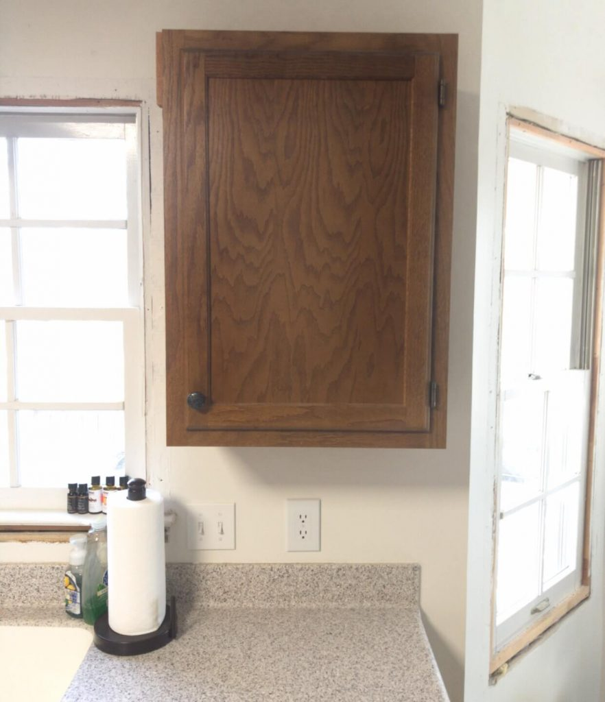 single brown cabinet on wall in kitchen