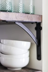 closeup of open shelving kitchen shelves