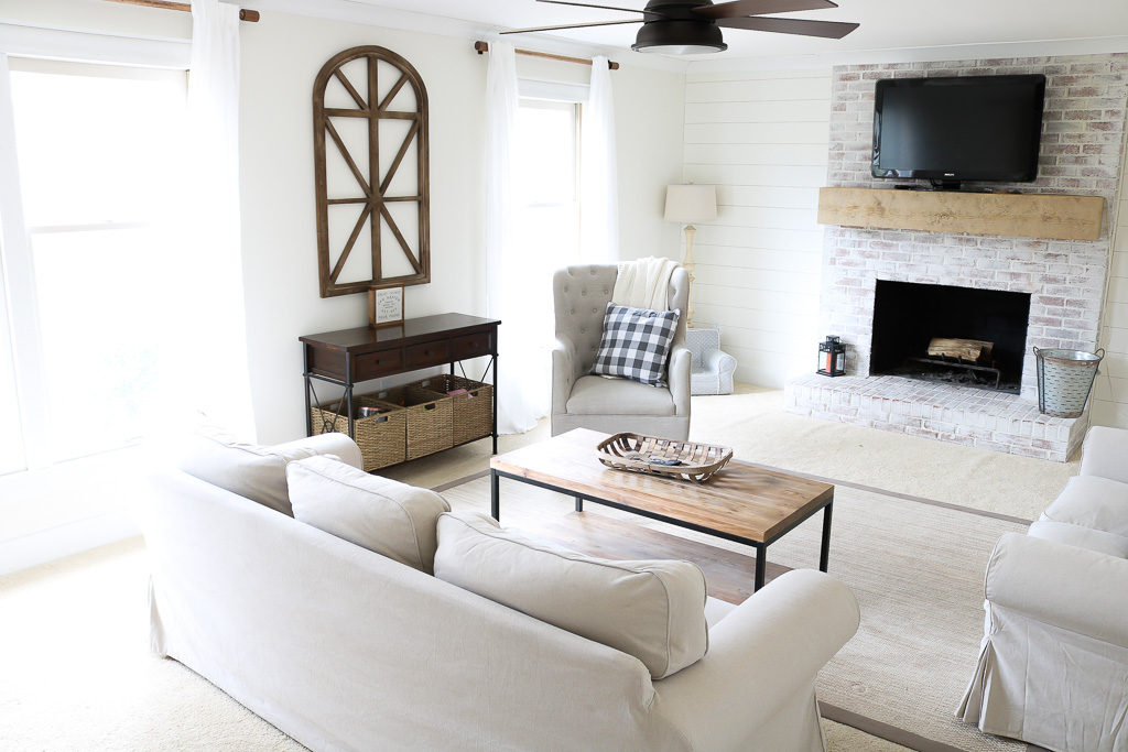 tan couches and white Sherwin Williams Alabaster walls with a modern farmhouse feel