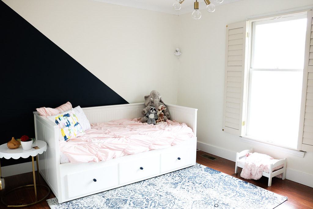 diagonal navy and white wall with IKEA Hemnes daybed