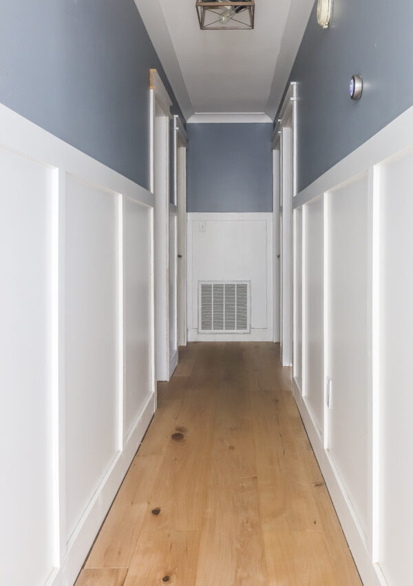 DIY board and batten in a hallway with natural wood floors