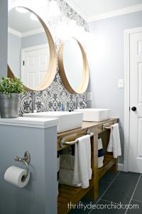 black and white wall tile bathroom with wood vanity and vessel sinks