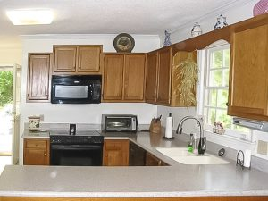 We are giving you down and dirty truth about painting kitchen cabinets