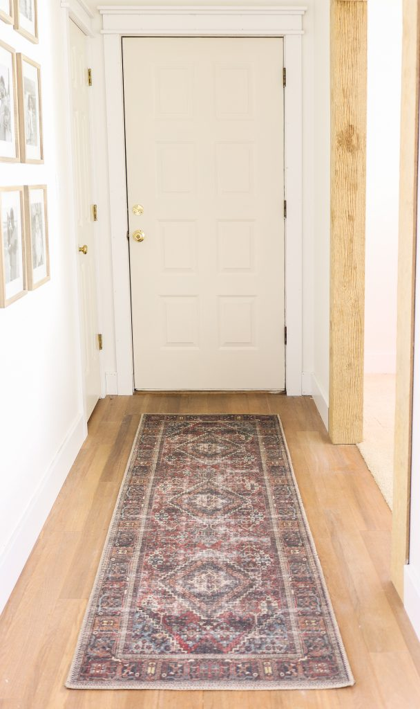 entry rug with gallery wall on the left side of the wall