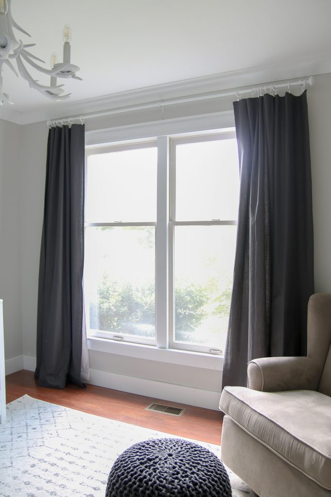 Make any curtains into blackout curtains with a couple bucks and this easy trick