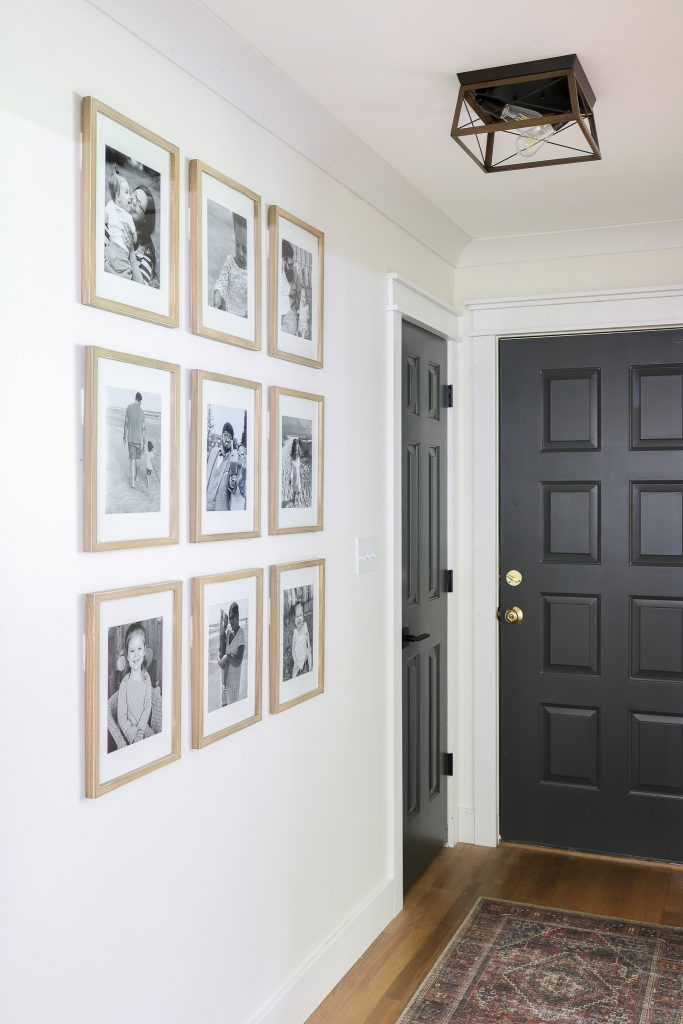 small entry way grid gallery wall