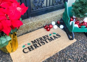 DIY Christmas doormat that says Merry Christmas