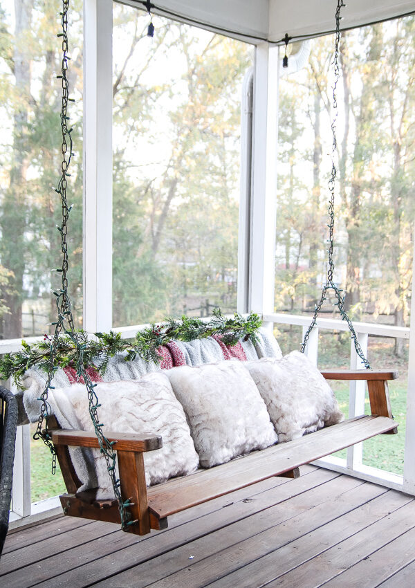 back porch swing decorated for Christmas