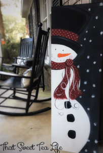DIY snowman sign on front porch for Christmas