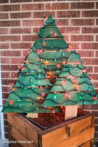 DIY wood Christmas trees outside in wood planter boxes