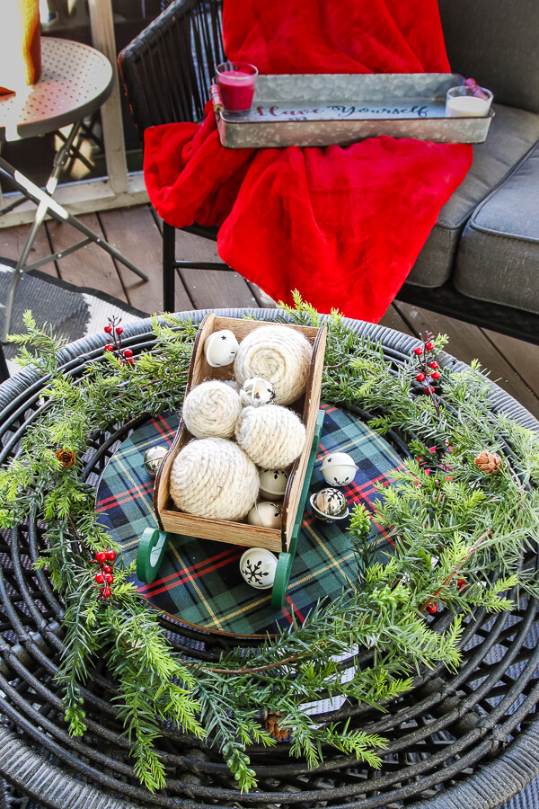 closeup of DIY yarn balls in sled