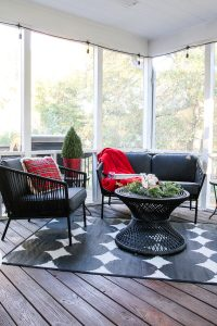 christmas porch decor with black and gray porch furniture