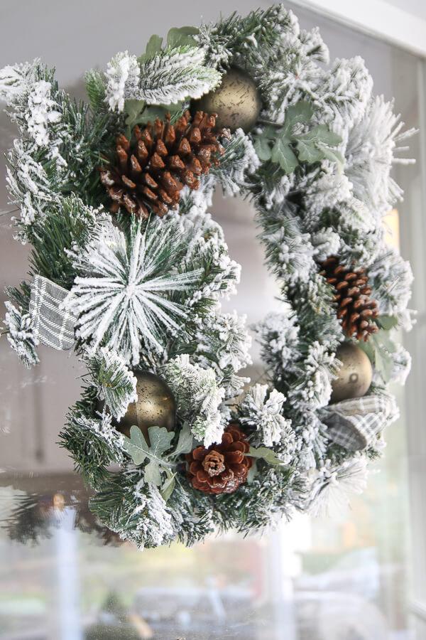 closeup of christmas wreath hanging on the window