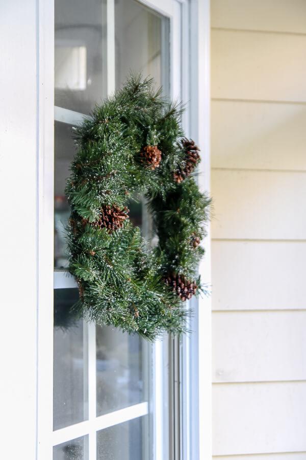closeup of christmas wreath hanging on a window