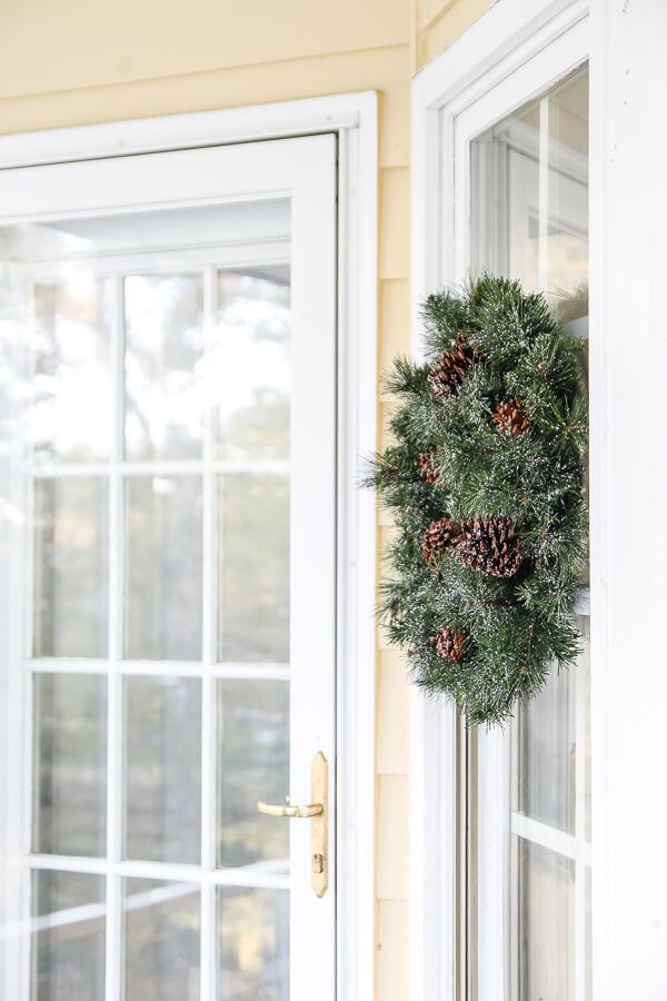 christmas wreath hanging on window