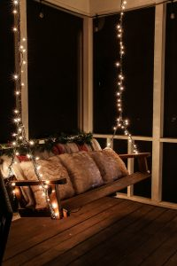 porch swing with christmas lights wrapped around it