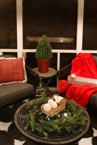 back porch christmas decorations with plaid pillow with fur and red blanket