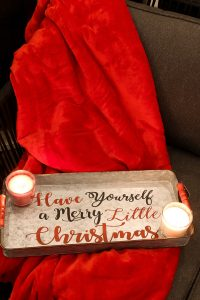 have yourself a merry little christmas tin with red blanket and candles