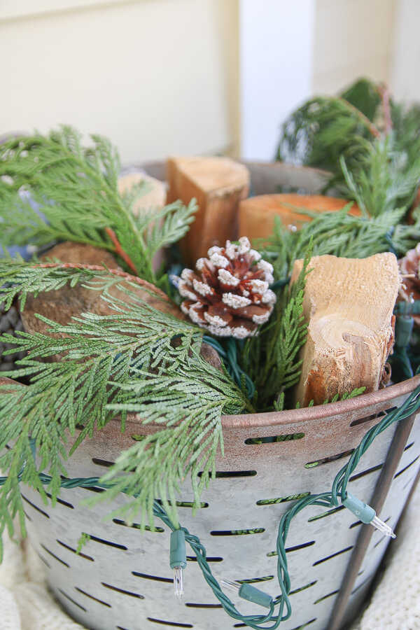 closeup of wood and garland in galvanized bucket
