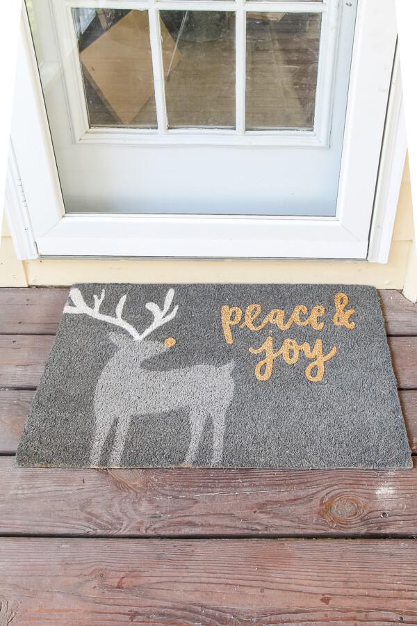 gray peace and joy christmas mat with deer