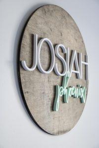 Josiah Phoenix circular wood cut sign