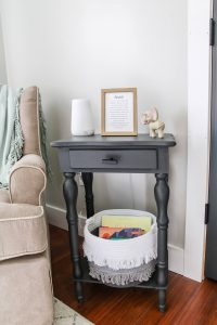 grey side table in nursery