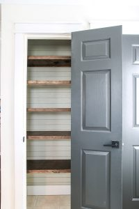 wood pantry shelving and shiplap