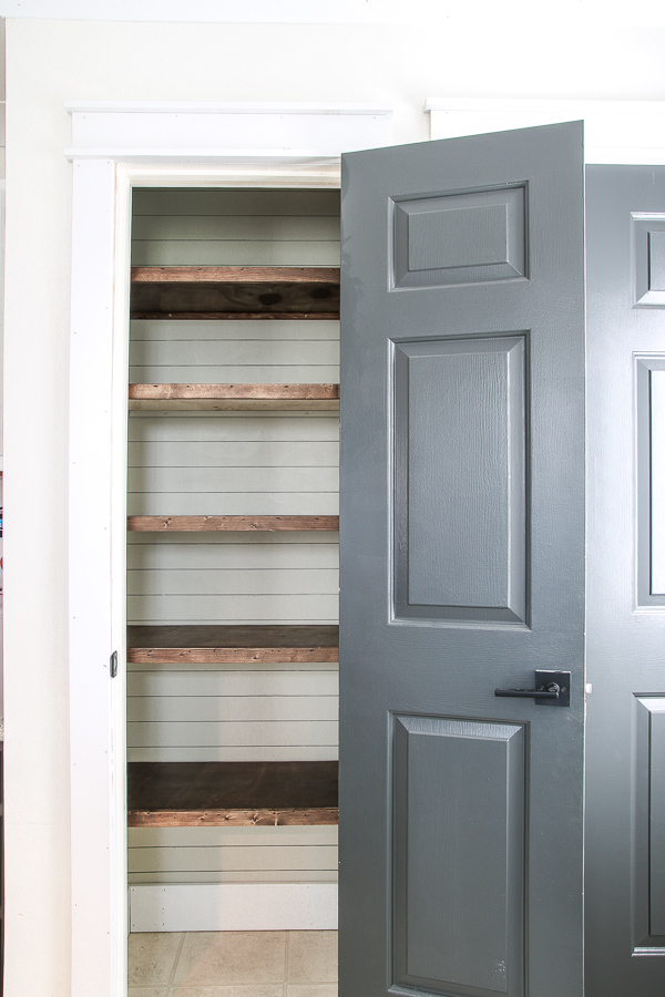 wood pantry shelving and shiplap
