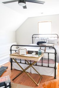 upstairs guest bedroom with black iron bed