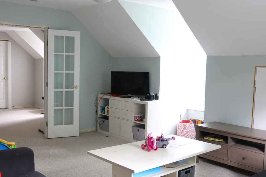 slanted ceiling painted in SW Sea Salt with TV on white console