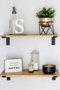 styled wood shelves over the toilet storage