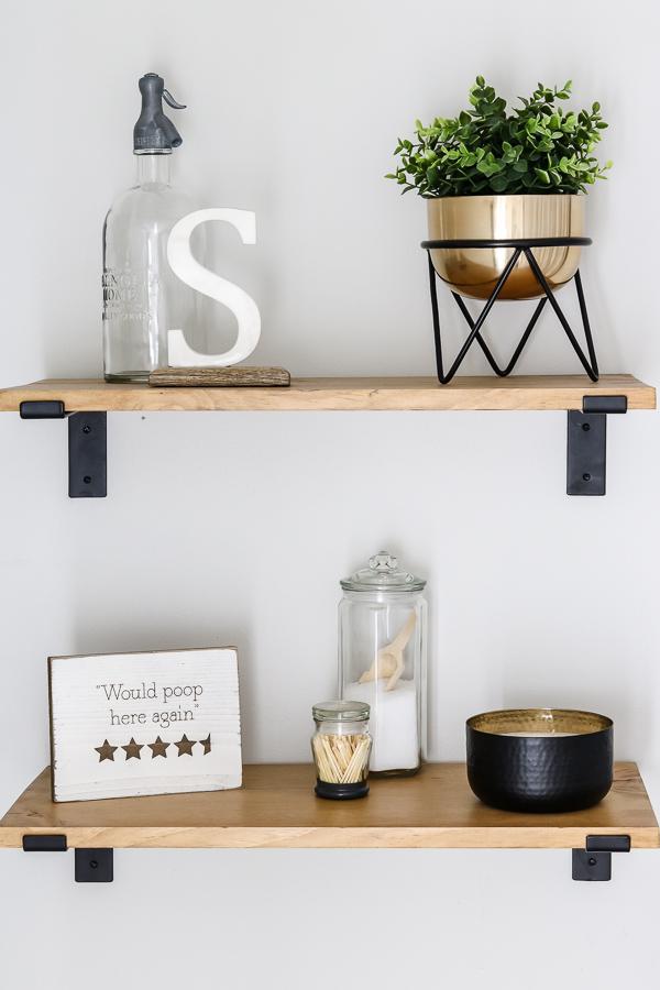 simple styled bathroom wood shelves  | Living Letter Home #guestbathroom #beforeandafter #bathroomrenovation #budgetbathroomremodel #smallbathroom