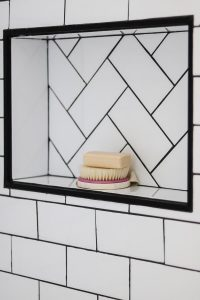DIY bathroom niche with herringbone subway tile