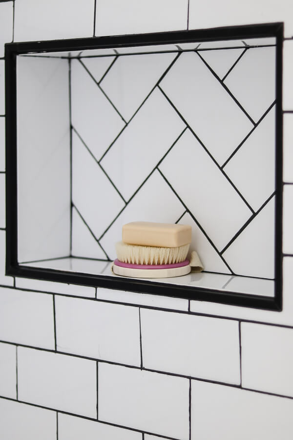 DIY bathroom niche with herringbone subway tile