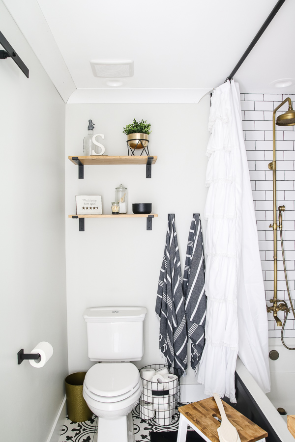 black and white guest bathroom renovation with white subway tile and black grout