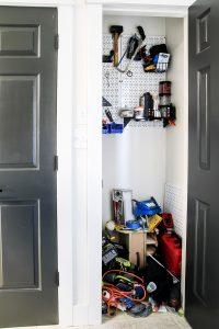 door open to show messy tool closet