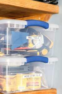organized tools in clear plastic bins labeled