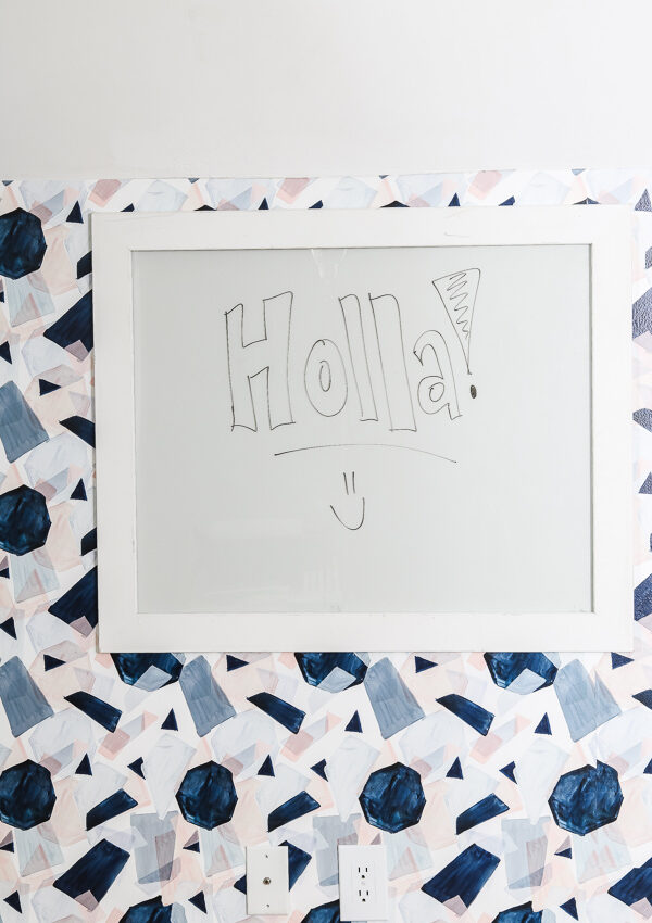 a simple way to create a DIY glass dry erase board for your office or command center using 1x3s and glass from a 16x20 frame #dryeraseboard #glasswhiteboard #glassdryeraseboard