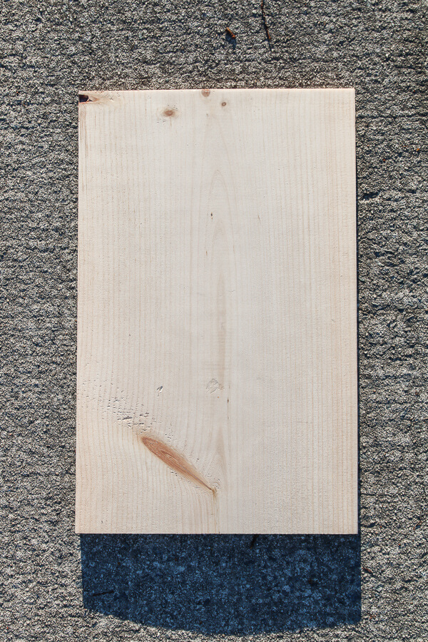 piece of wood laying on concrete