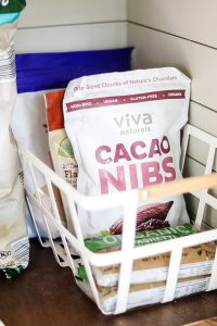 cacao nibs in white metal basket