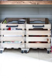 2 wood crates on casters in the bottom of the organized pantry