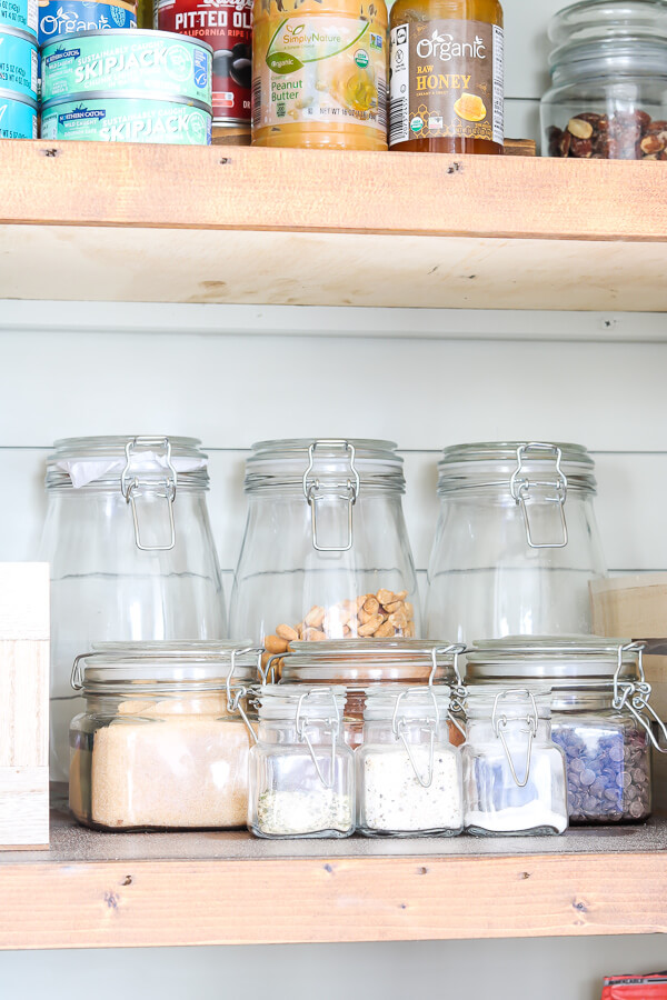 organized glass hocking jars in small pantry