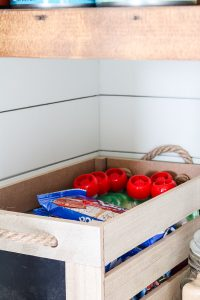 wooden crate with organized toddler foods