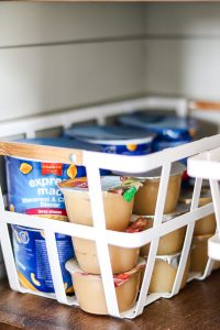 applesauce and easy mac in white basket