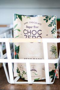 choc zero in white metal basket in pantry closet
