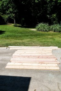 lumber laying in driveway