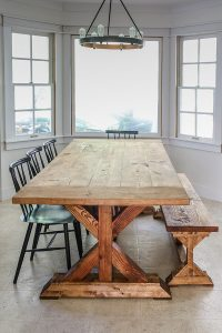 stained and finished farmhouse table and bench in kitchen