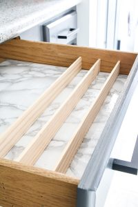 lattice wood in drawer with marble contact paper for DIY k cup storage