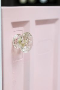 Adding a sweet touch of a glass doorknob on your Little Tikes playhouse makeover